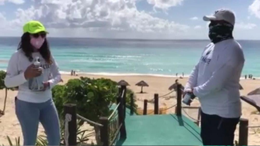 Cumplen bañistas protocolos sanitarios en reapertura de playas de Cancún
